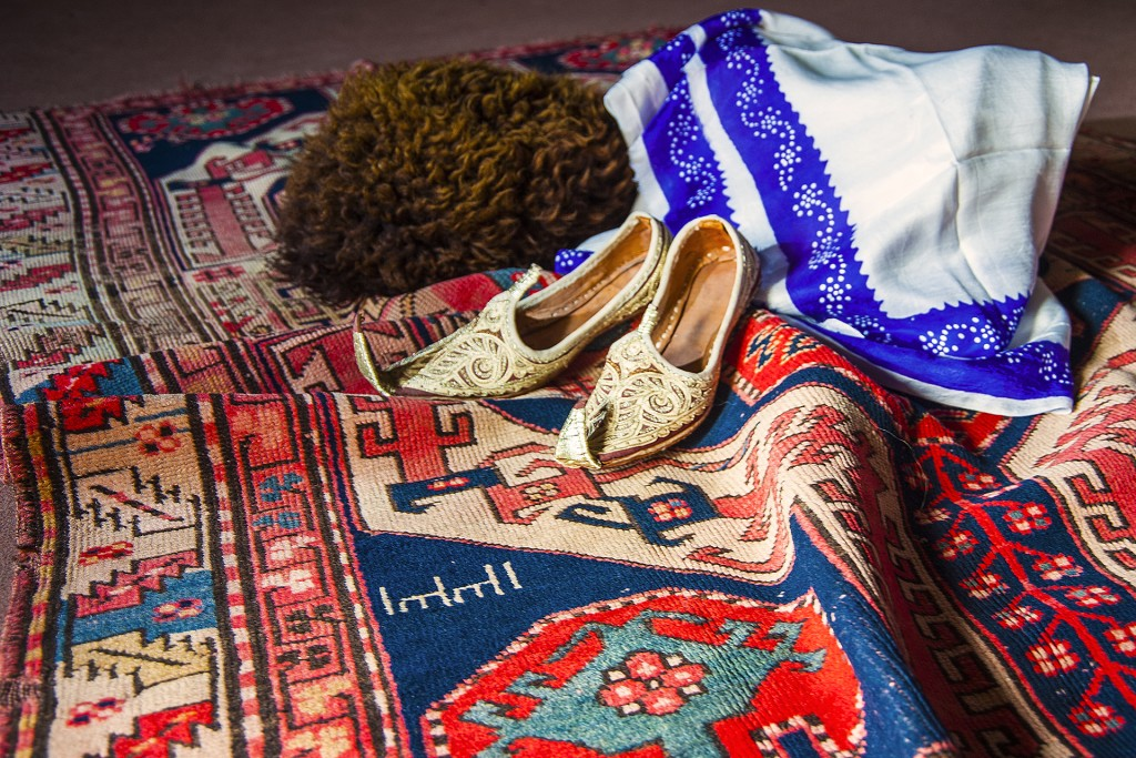 Azerbaijani hat, woman shoes and kelaghayi on carpet, Garabagh school © Eldar Fazraliyev